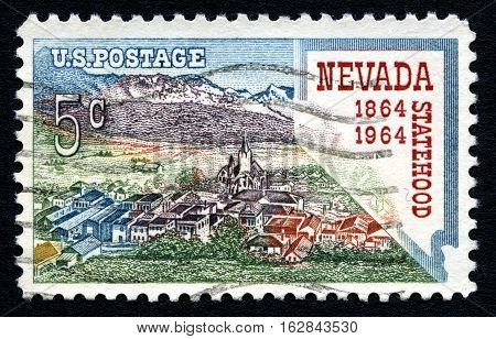 UNITED STATES OF AMERICA - CIRCA 1964: A used postage stamp from the USA celebrating the 100th Anniversary of Nevada Statehood circa 1964.