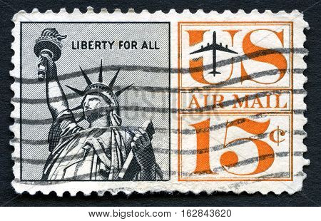 UNITED STATES OF AMERICA - CIRCA 1961: A used US air mail postage stamp depicting an illustration of the iconic Statue of Liberty circa 1961.