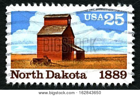 UNITED STATES OF AMERICA - CIRCA 1989: A used US Postage Stamp commemorating the 100th Anniversary of North Dakota statehood circa 1989.
