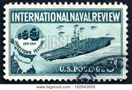 UNITED STATES OF AMERICA - CIRCA 1957: A used postage stamp from the USA depicting an Aircraft Carrier and the Jamestown Festival logo commemorate the international Naval Review circa 1957.