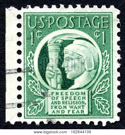 UNITED STATES OF AMERICA - CIRCA 1943: A used US postage stamp illustrating the message Freedom of Speech and Religion from Want and Fear circa 1943.
