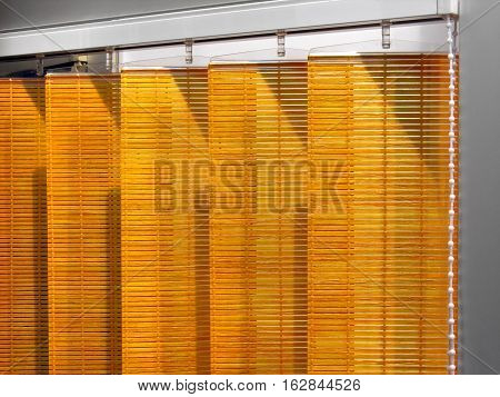 part of wooden Venetian blinds system in home