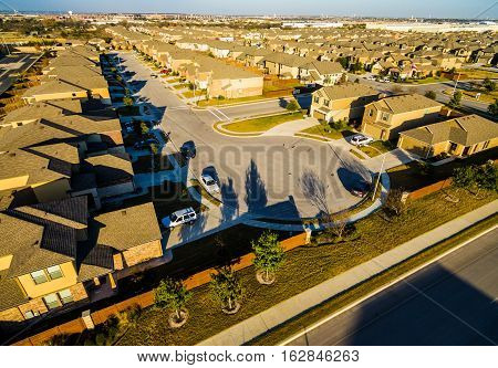 Sunset Suburban Homes North of Austin near Round Rock , Texas as Texas expands more and more homes are built in Modern Neighborhood Communities at Cul de Sac golden hour sunset