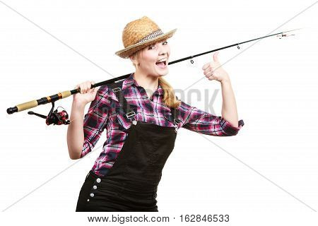 Spinning angling cheerful fisherwoman concept. Happy woman in sun hat holding fishing rod having fun and smiling.
