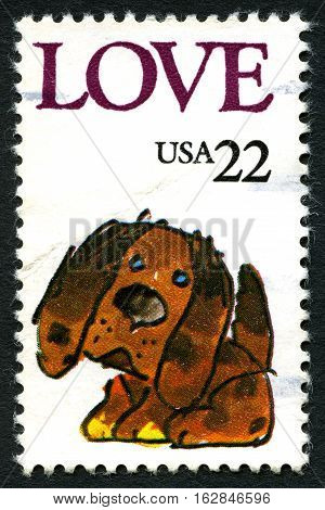 UNITED STATES OF AMERICA - CIRCA 1986: A used postage stamp from the USA portraying LOVE and an illustration of a puppy circa 1986.