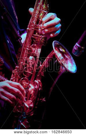 saxophone player in live perfomance on stage