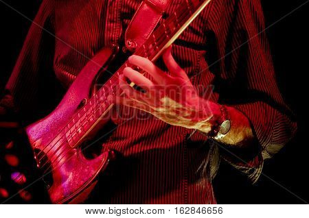 bass guitar player live on stage, band
