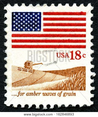 UNITED STATES OF AMERICA - CIRCA 1981: A used postage stamp from the USA showing an agricultural scene and a phrase from the song America the Beautiful circa 1981.