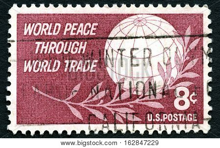 UNITED STATES OF AMERICA - CIRCA 1959: A used US postage stamp promoting the message of World Peace Through Trade circa 1959.