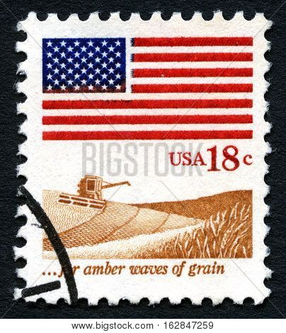 UNITED STATES OF AMERICA - CIRCA 1981: A used US postage stamp depicting the Stars and Stripes flag and celebrating farming and cultivation of land circa 1981.