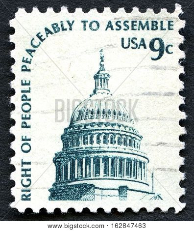 UNITED STATES OF AMERICA - CIRCA 1975: A used postage stamp from the USA depicting an illustration of the Capitol building in Washington and the phrase 'Right of People Peaceably to Assemble circa 1975.