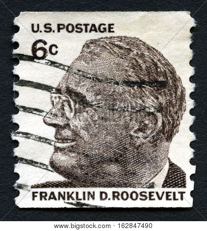 UNITED STATES OF AMERICA - CIRCA 1966: A used postage stamp from the USA featuring an illustration of former president of the United States of America Franklin D. Roosevelt circa 1966.