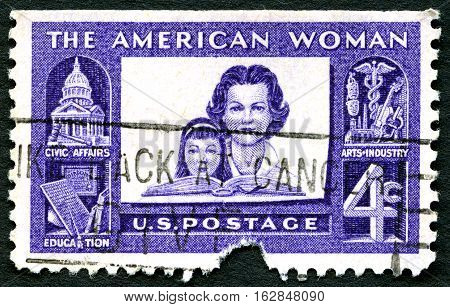 UNITED STATES OF AMERICA - CIRCA 1960: A used postage stamp from the USA celebrating the American Woman circa 1960.