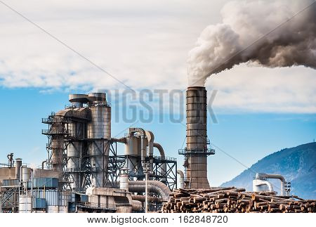 Chemical plant for the processing of chipboard and smokestack of a furniture factory