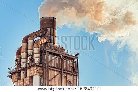 Old Smokestack That Emits Smoke.