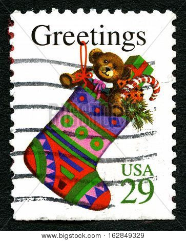 UNITED STATES OF AMERICA - CIRCA 1993: A used postage stamp from the USA wishing Christmas Greetings and an illustration of a Christmas Stocking circa 1993.