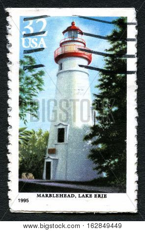 UNITED STATES OF AMERICA - CIRCA 1995: A used postage stamp from the USA depciting an illustration of Marblehead Lighthouse on Lake Eerie circa 1995.