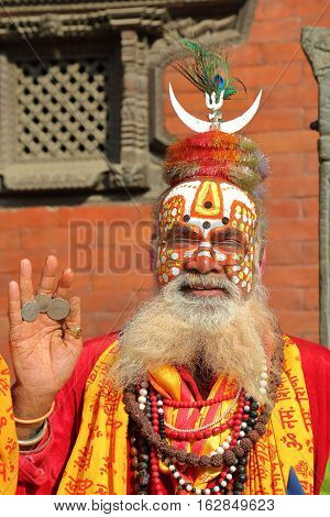 KATHMANDU, NEPAL - JANUARY 14, 2015: Portrait of a Sadhu (Holy man) in Durbar Square