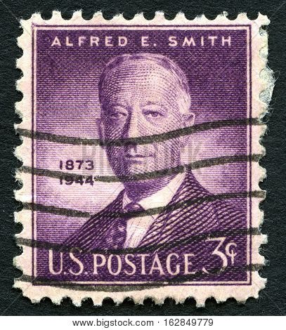 UNITED STATES OF AMERICA - CIRCA 1945: A used US postage stamp with a portrait of historic American statesman Alfred E. Smith circa 1945.