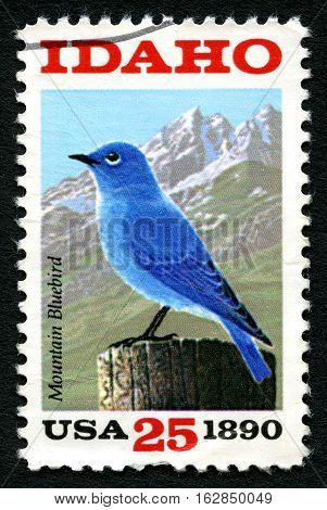 UNITED STATES OF AMERICA - CIRCA 1990: A used postage stamp from the USA depicting an illustration of the Mountain Bluebird - the state bird of Idaho circa 1990.