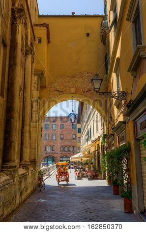 Archway With Unidentified People In Lucca, Tuscany, Italy