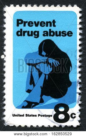 UNITED STATES OF AMERICA - CIRCA 1971: A used postage stamp from the USA devoted to preventing drug abuse circa 1971.