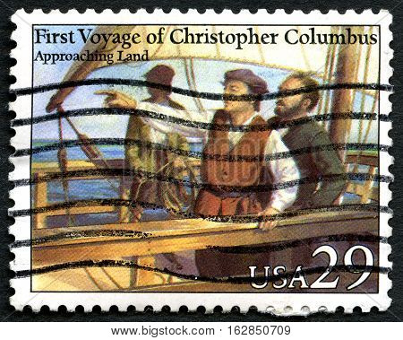 UNITED STATES OF AMERICA - CIRCA 1992: A used postage stamp from the USA depicting an illustration of Christopher Columbus Approaching Land circa 1992.