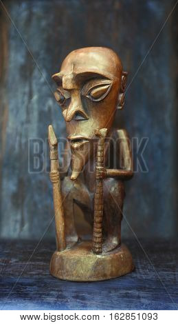 Wooden figure on a table on a blue background