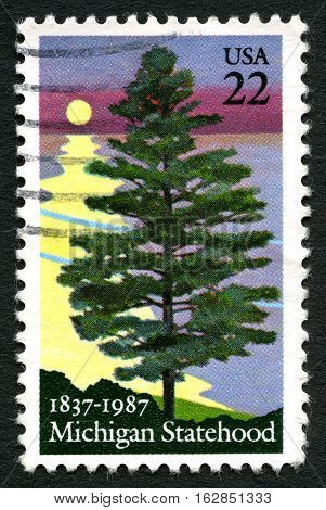 UNITED STATES OF AMERICA - CIRCA 1987: A used postage stamp from the USA celebrating the 150th Anniversary of Michigan Statehood circa 1987.