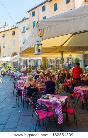 Restaurant On The Piazza Del Anfiteatro In Lucca, Italy