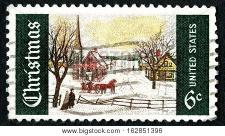 UNITED STATES OF AMERICA - CIRCA 1969: A used postage stamp from the USA depciting a beautiful Snowy Christmas scene circa 1969.