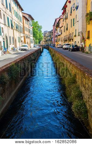 Street View With Canal In Lucca, Tuscany, Italy