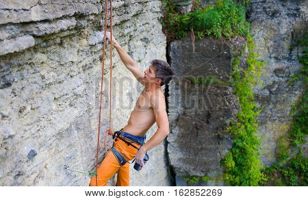 Climber Climbs The Rock.