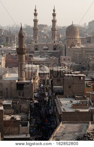 Overpopulated dusty Old Cairo street view from above with old mosques and minarets in Cairo Egypt
