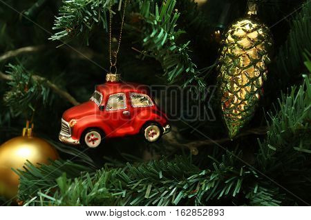 Red car cone and ball decorations on faux christmas tree