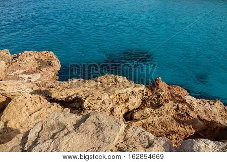Detailed view of crystal clear sea water and rocks in the coast