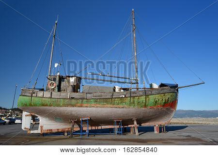 image of old wooden sailing vessel on supports