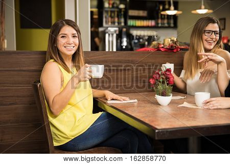 Pretty Girl Drinking Coffee With Her Friends