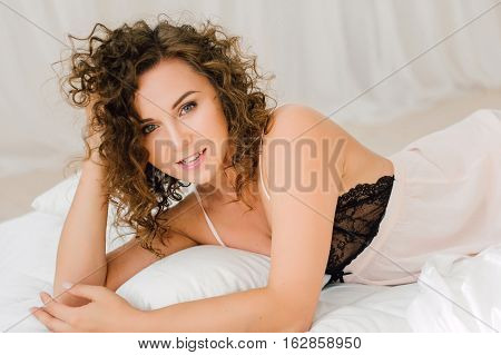 Sexy Woman In Bed In The Morning Showing Her Beautiful Body. Awaken With Natural Light In Her Bedroo