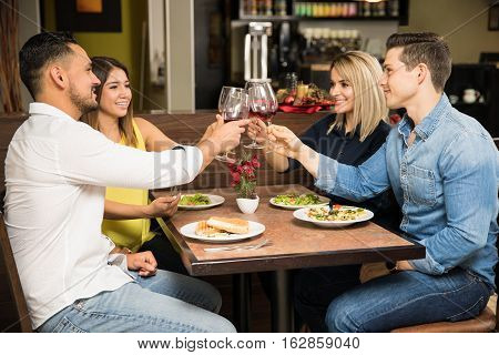 Two Couples Eating Out Together