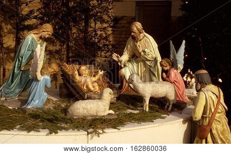 Colorful Nativity with photo baby Jesus Mary Joseph an angel and other famous religious figures of the bible enhanced with rays of light