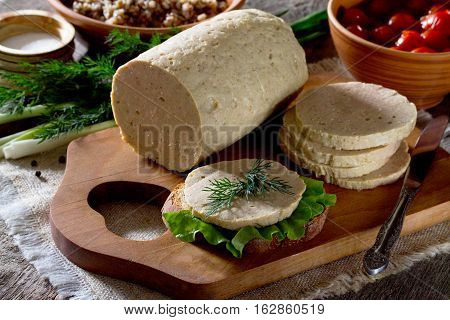 Sandwich With Homemade Dairy Meat Sausage And A Variety Of Vegetables, Herbs On Rustic Background.