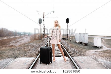 Beautiful Lady. Pretty Adult Woman With Luggage Near The Old Railcar For Travel.