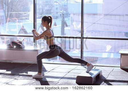Fitness Instructor Doing Aerobics Aerobics Dancing Exercises In Sport Club With Step