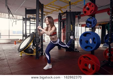 Athletic Woman Workout Out Squats Weighted Lunges Exercise For Butt Legs With Suspension Straps In F