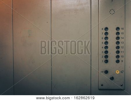 Lift or Elevator buttons and wall inside interior with copy space. Background toned image