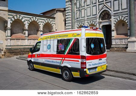 Florence Italy - July 06 2016: ambulance van in front of a historic church in Florence. In medieval time Florence was the center of European trade and one of the wealthiest cities