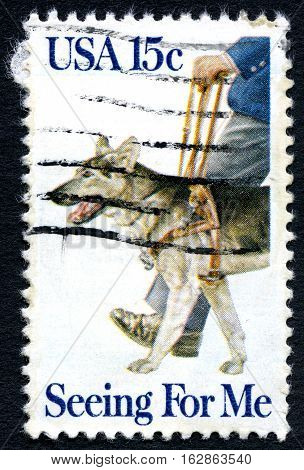 UNITED STATES OF AMERICA - CIRCA 1979: A used postage stamp from the USA depicting an illustration of a Guide Dog for the Blind circa 1979.