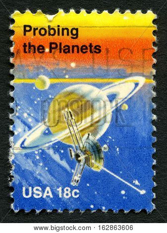 UNITED STATES OF AMERICA - CIRCA 1981: A used postage stamp from the USA depicting an illustration of Saturn and Pioneer II celebrating achievements in Space circa 1981.