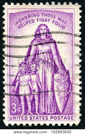 UNITED STATES OF AMERICA - CIRCA 1957: A used postage stamp from the USA honoring those who have helped fight Polio circa 1957.
